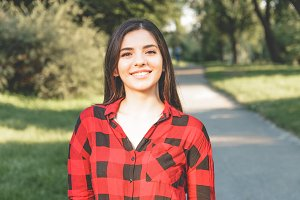Happy woman in a red plaid shirt