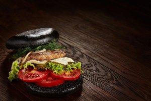 Black burger on vintage wooden