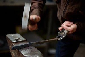 Close-up of a blacksmith's hands