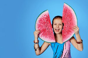 Funny girl in swimsuit, watermelon.