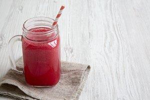 Glass jar of watermelon smoothie