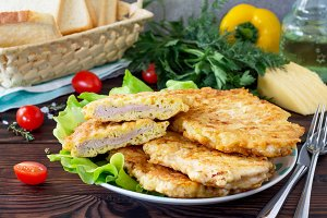 Grilled chicken breasts with cheese.