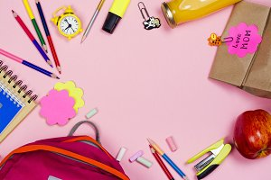 School supplies on pink background
