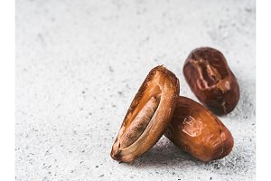Dried dates on gray cement,copyspace