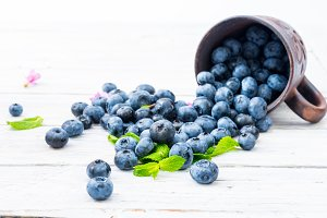 A lot of blueberries on the table.