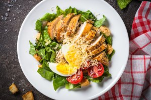 Caesar salad with chicken breast and