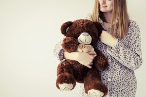 Teen girl with teddy bear
