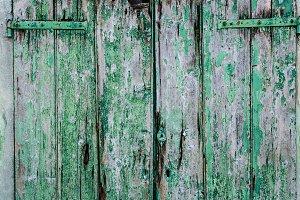 Old green painted wood door
