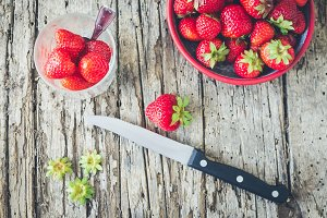 Ripe strawberries on a cutting board
