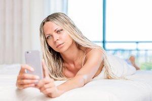 Pretty blonde woman taking selfie in
