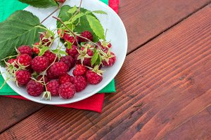 berries of red raspberries in a bowl