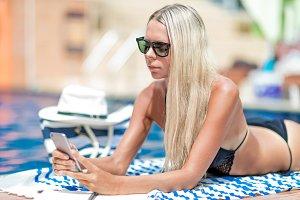 Young blonde girl freelancer in biki