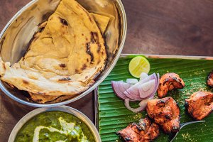 Assorted indian food on dark wooden