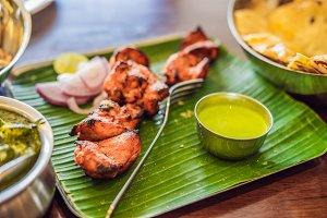 Assorted indian food on dark wooden