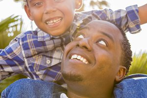 African American Father and Son Play