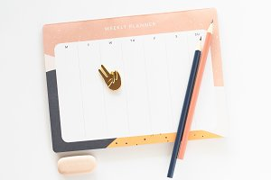 Stock Photo - Weekly planner, pencil