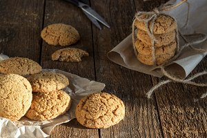 oatmeal cookies with milk on wooden