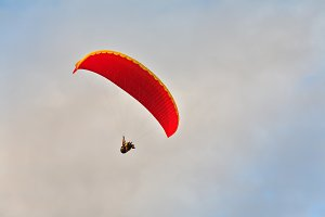Flight on an parachute on a sunset