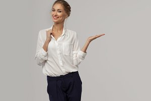 A beautiful business woman in a whit