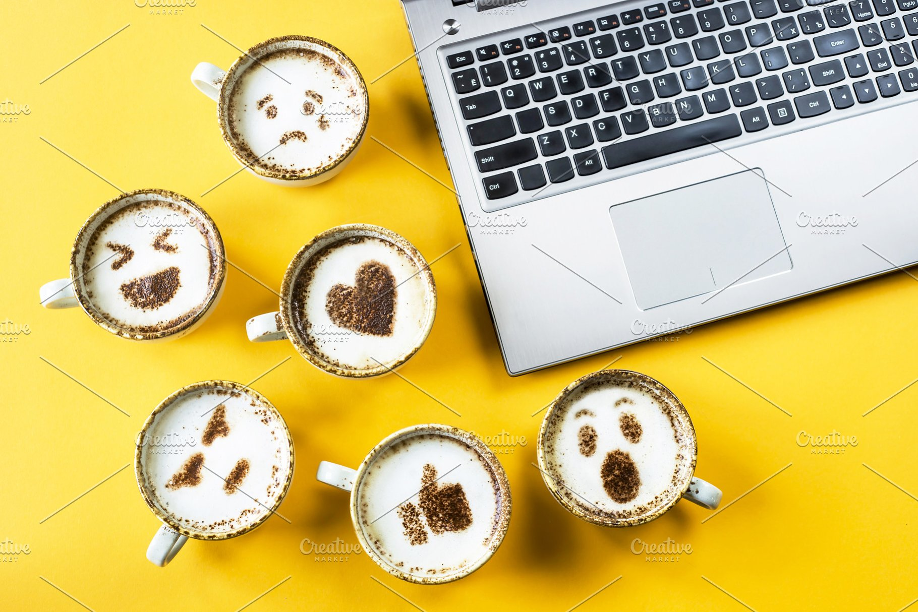Emoji from Facebook on cups of coffe