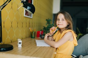 Photo of girl with pencil and