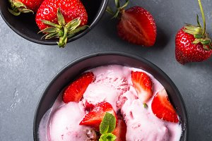 Strawberry ice cream on gray table