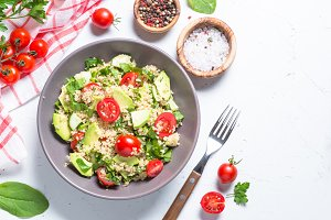 Quinoa salad with spinach, avocado