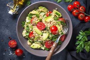 Quinoa salad with spinach, avocado