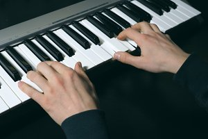 Hands of male musician playing at