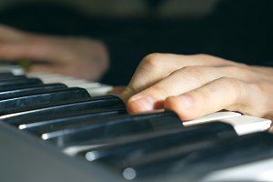 Fingers of pianist at the piano keys