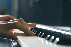 Close up fingers of pianist at the