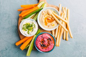 Fresh vegetarian dips in small bowls