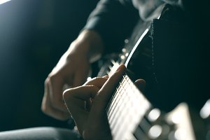 Close up fingers of guitarist at the