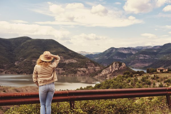 Stock Photos: MONNKA - A hiking girl looking at the river
