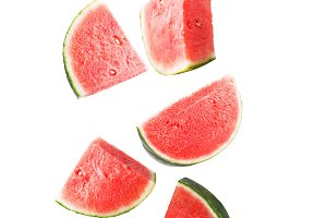 Falling watermelon isolated on white