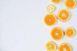 Slices of orange on concete