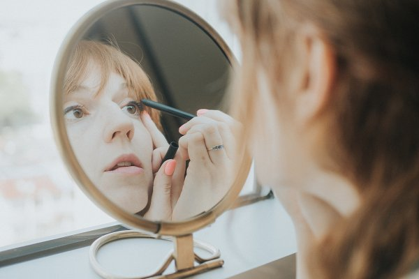 People Stock Photos: Will Milne Photography - Woman Applying Makeup in Mirror