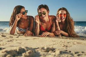 Woman friends sunbathing