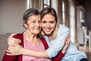 An elderly grandmother with an adult