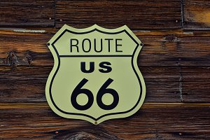 Route 66 sign with wooden background