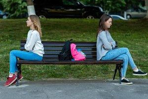Two girls schoolgirl. In summer they