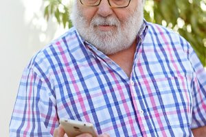 Senior man with a smartphone