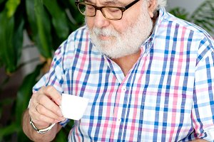 Senior bearded man drinking coffee