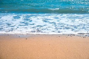 Blue sea and beach with golden sand