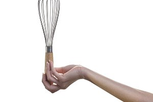 Woman hand holding whisk egg for bea