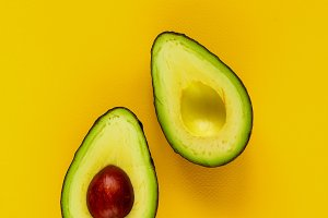 Avocado on yellow