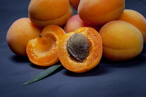 Apricot and halve with stone on dark