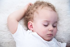Sleeping one year old baby boy with