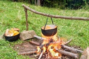 Cauldron with cooking boiling on the