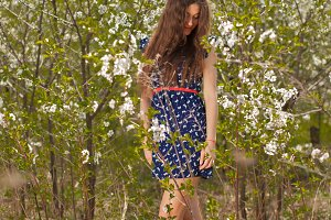 beautiful girl in a summer dress sur